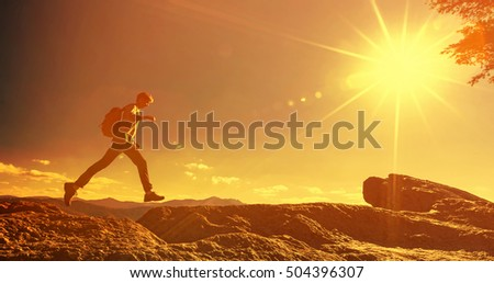 Hiker Walking Winter Carpathian Mountains Stock Photo - This man hikes up the transylvanian mountains every morning to photograph sunrise