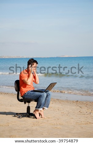 Man listening to music on the beach