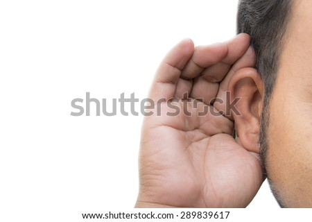 Man listening with her hand on an ear