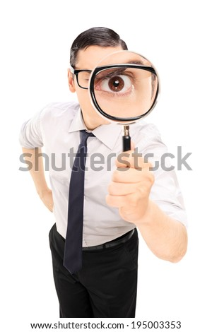 Man looking through a magnifying glass isolated on white background