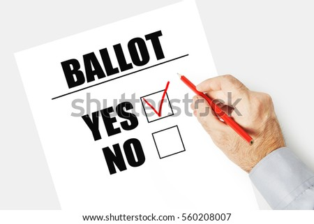 Man marks checkbox YES on the ballot