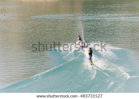Man on Jet Ski on lake in the quarry in summer, golden hour, Ukhta, Russia, 19.07.2016