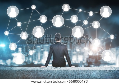 Man on rooftop looking at people icons. Human resources concept
