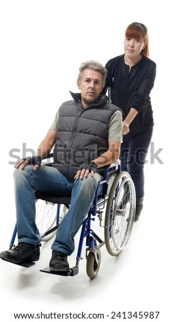 man on wheelchair with asian woman helping him