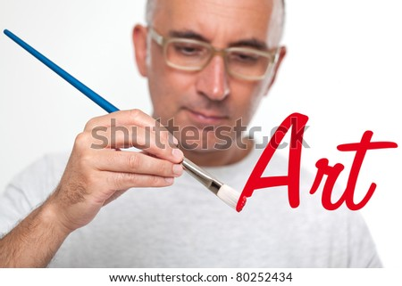 Man painting on a glass board