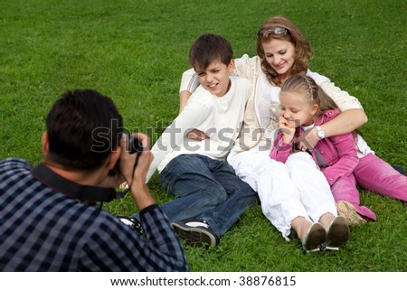 man photographer his family outdoors