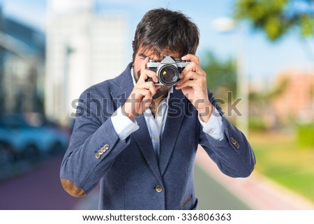Man photographing on unfocused background