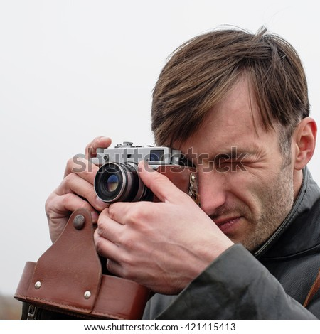 man photographs the old film camera