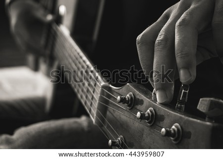 Man Playing Guitar in Black and White tone