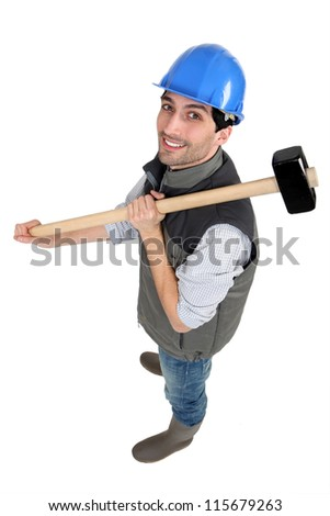 Man posing with sledge hammer