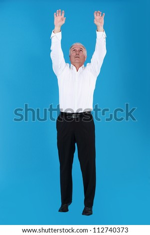 Man reaching for the sky