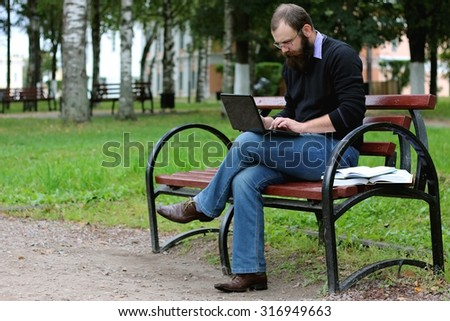 man reading books in the park