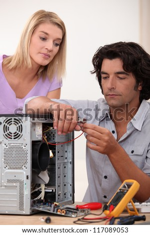 Man repairing PC for colleague