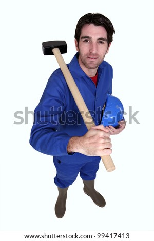 Man resting sledge-hammer on shoulder