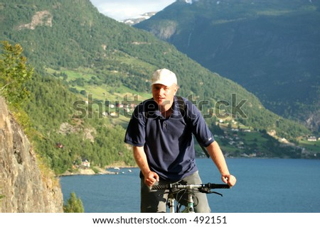 man riding on bicycle in the mountains