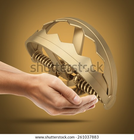 Man's hand holding golden Empty trap. High resolution 3D. collection of gold objects