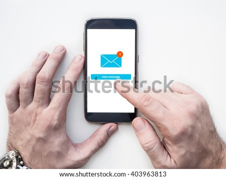 Man's hands using smartphone with Email app interface on screen