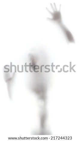 Man screaming against a transparent glass prison