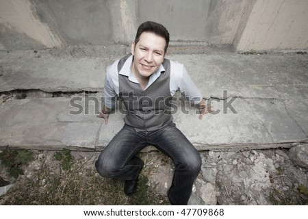 Man sitting and looking up at the camera