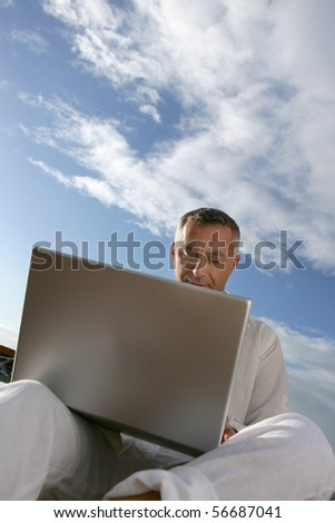 Man sitting in front of a laptop computer