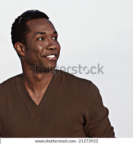Man smiling and glancing sideways