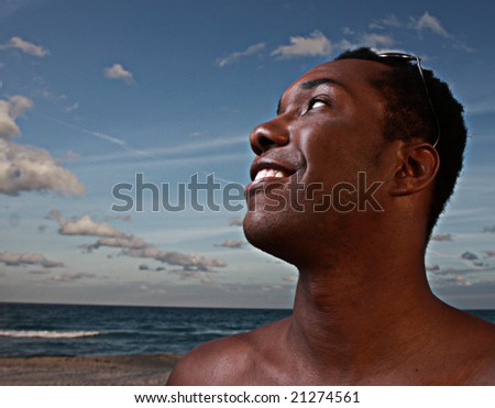 Man smiling on a beautiful sky background