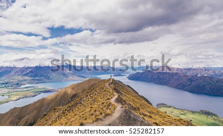 Man stand on Roy's Peak in New Zealand