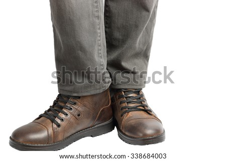 Man standing in jeans and shoes on a white background