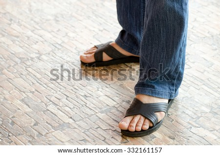 man standing on the walkway, Man feet