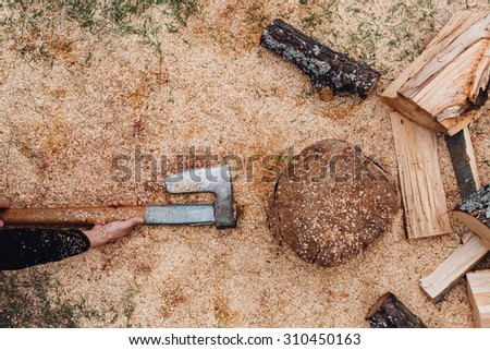 Man takes an ax for cutting wood