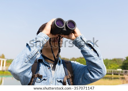 Man using binoculars for birdwatching