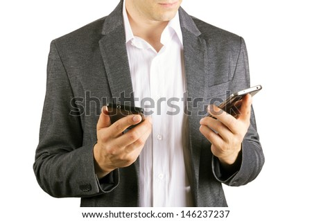 man using two cellphones