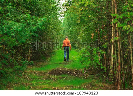 Man Walking in the Wet Forest