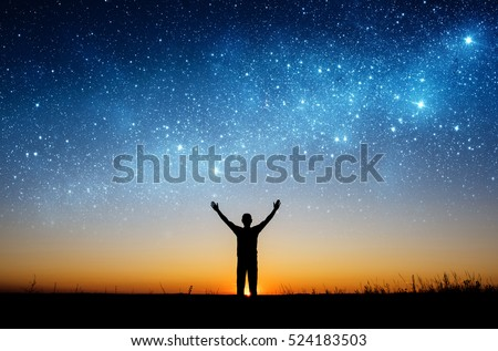 Man watching the stars. Elements of this image furnished by NASA.