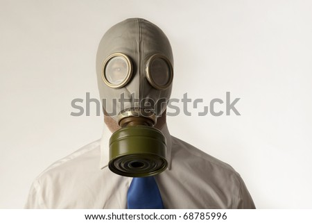 man wearing a gas mask in a shirt and tie