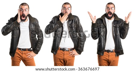 Man wearing a leather jacket doing surprise gesture