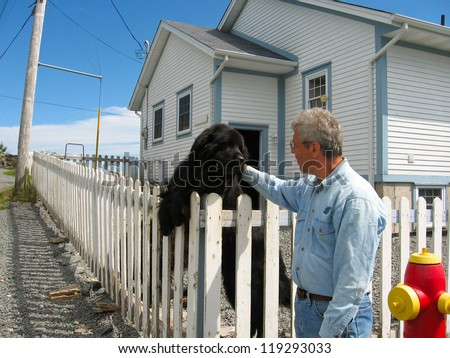 Man with a Newfoundland dog
