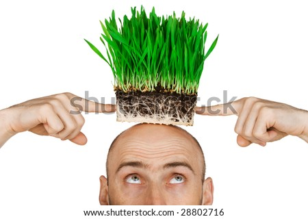 Man with a patch of green grass on his head.  Isolated against a white background.