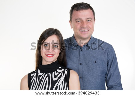 Man with adult daughter looking at the camera