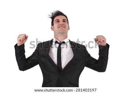 man with black suit with fists raised