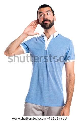 Man with blue shirt listening something