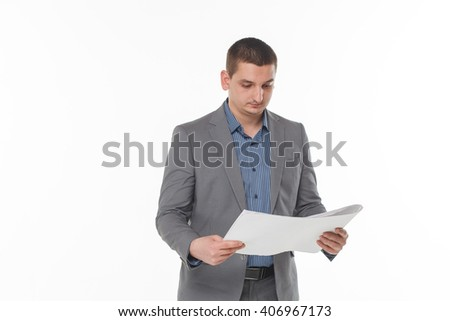 man with blueprints in hand white studio