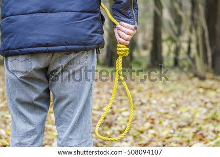 Man with gallows noose at outdoor