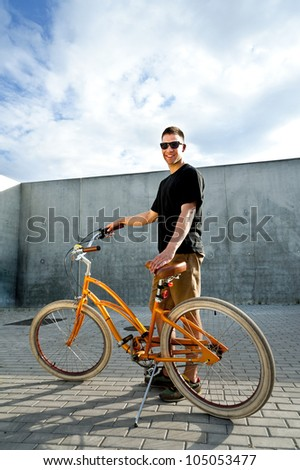 man with glasses on bike on the street
