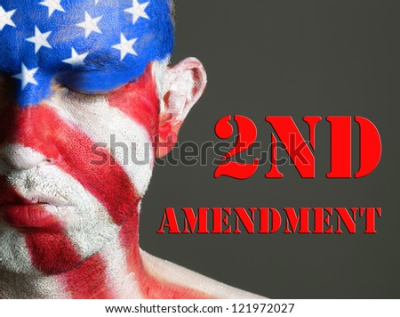 Man with his face painted with the flag of USA. Second Amendment expression concept.
