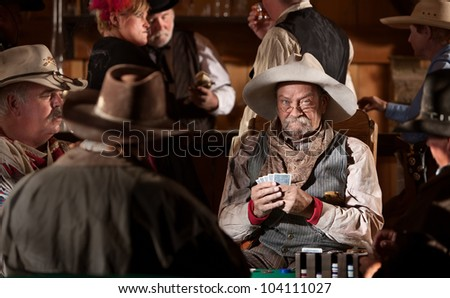 Man with poker face in American old west scene