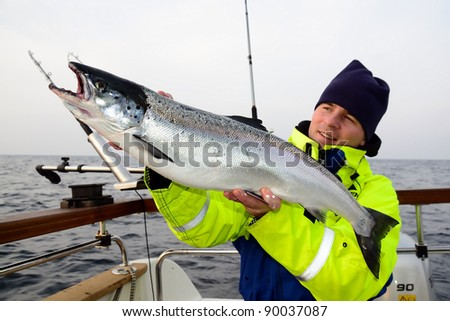 Man with trophy fish in his hands