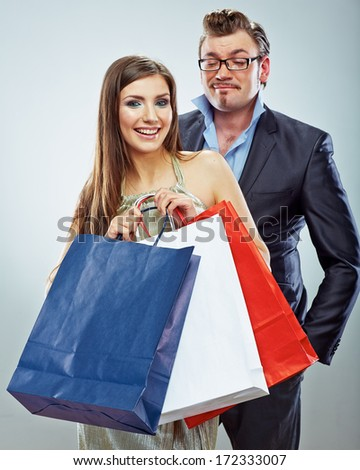 Man, woman couple shopping portrait. Shopping bags. White background.