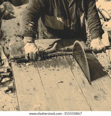 Man working with old handmade circular saw blade