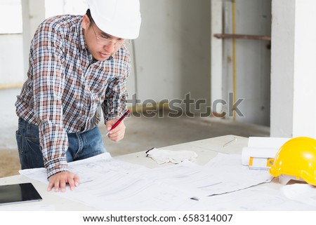 Management consulting engineers foreman working blueprint stock management consulting with engineers working with blueprint and drawing on work table in for management business malvernweather Gallery